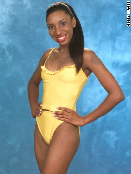 "Toward the end of the 1990s, women wanting the cuteness of a bikini but the coverage of a one-piece found salvation in the ""tankini."" Here, Sherece Shurmain Smith, Miss U.S. Virgin Islands 1999, models an Oscar de la Renta tankini."