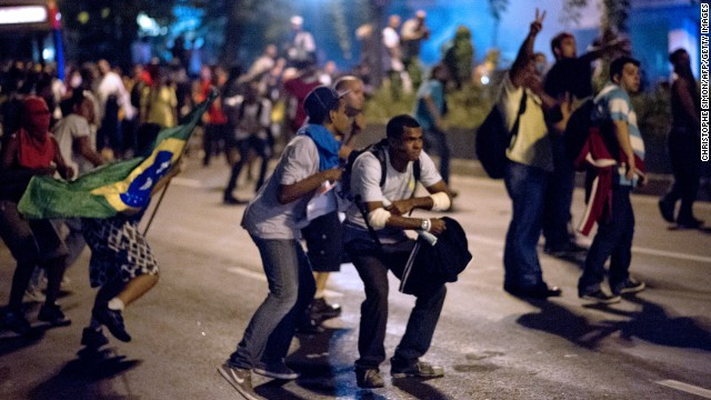 Protesters in Rio battled police late on June 19, even after Brazil's two biggest cities rolled back the transit fare hikes that triggered <a  data-cke-saved-href='http://edition.cnn.com/2013/06/18/world/americas/brazil-protests-montague/index.html?hpt=hp_c2' href='http://edition.cnn.com/2013/06/18/world/americas/brazil-protests-montague/index.html?hpt=hp_c2'>two weeks of nationwide protests</a>. The fare rollback in Sao Paulo and Rio de Janeiro marked a major victory for the protests, which are the biggest Brazil has seen in two decades.