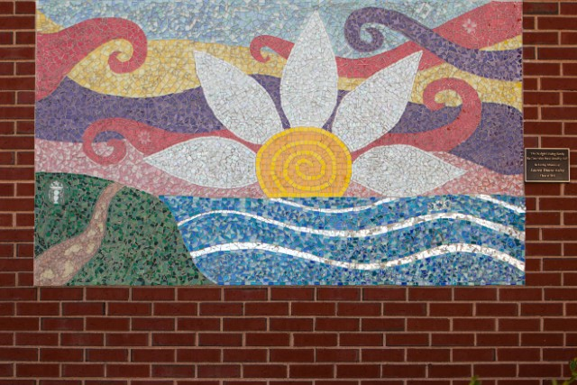 A mosaic in memory of Lauren Astley hangs at her alma mater, Wayland High School.