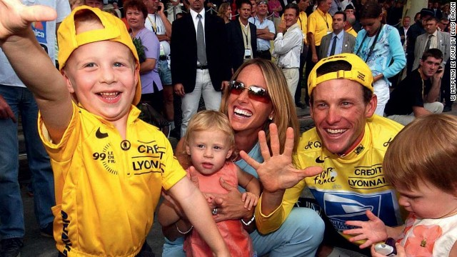 Armstrong and his family signal his fifth straight win in the Tour de France in 2003. The Texan was to eventually claim seven titles in a row, but was stripped of them in 2012 after revelations of doping emerged.