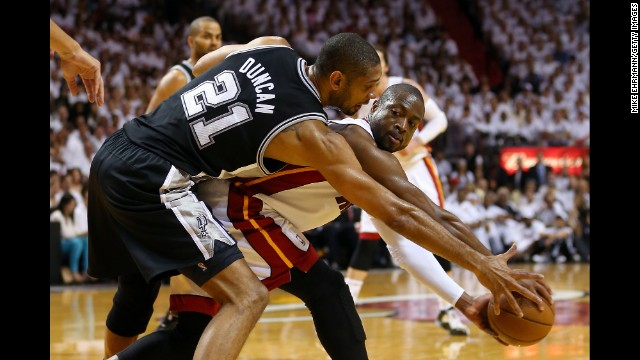 Dwyane Wade of the Miami Heat looks to pass the ball against Tim Duncan of the San Antonio Spurs.