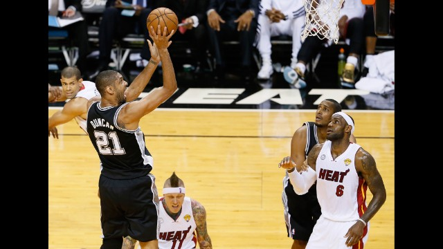 Tim Duncan of the San Antonio Spurs shoots over LeBron James of the Miami Heat.