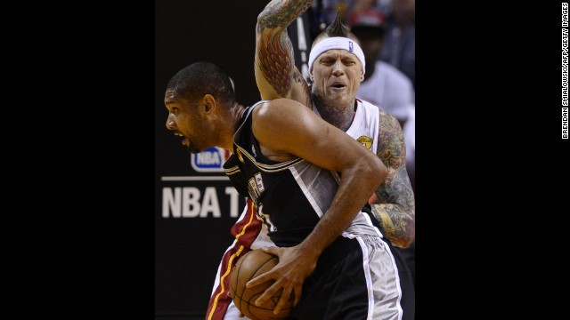 Chris Andersen of the Miami Heat guards Tim Duncan of the San Antonio Spurs.