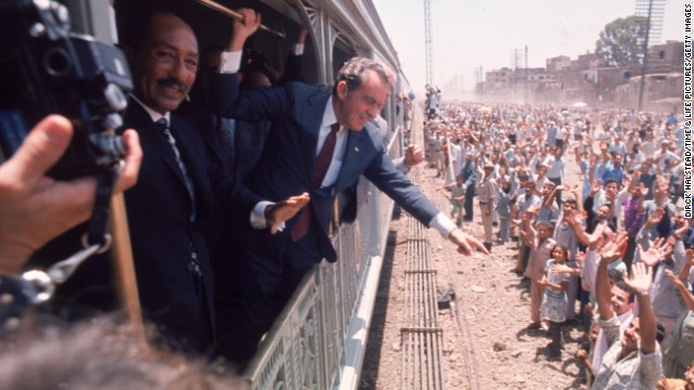President Richard Nixon and Egyptian President Anwar Sadat greet people in Egypt, in June 1974.