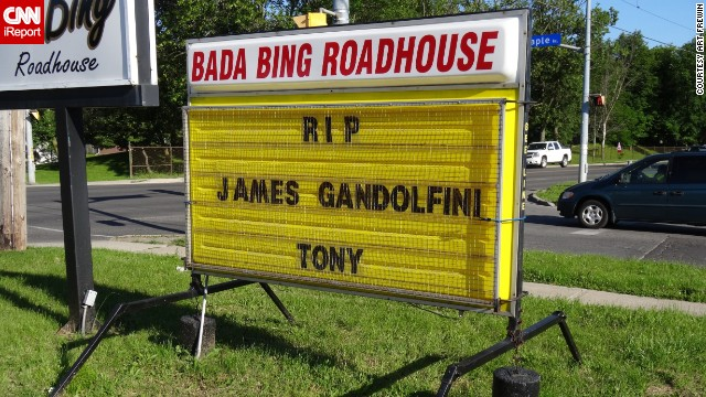 "<a href='http://ireport.cnn.com/docs/DOC-992506'>Art Frewin </a>named his Wellin, Ontario, bar the ""Bada Bing Roadhouse,"" inspired by ""The Sopranos,"" and paid tribute on the sign outside his establishment when he heard the news. ""I was sorry to see Tony ... James pass away. We'll always know him as Tony, you know. I thought he was a brilliant actor who played a brilliant part. I was very taken aback. 51 is way too young."""