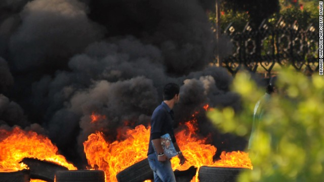 Burning tires are pictured in Tripoli, Lebanon, on Sunday amid protests in support of Sheikh Ahmed al-Asir.