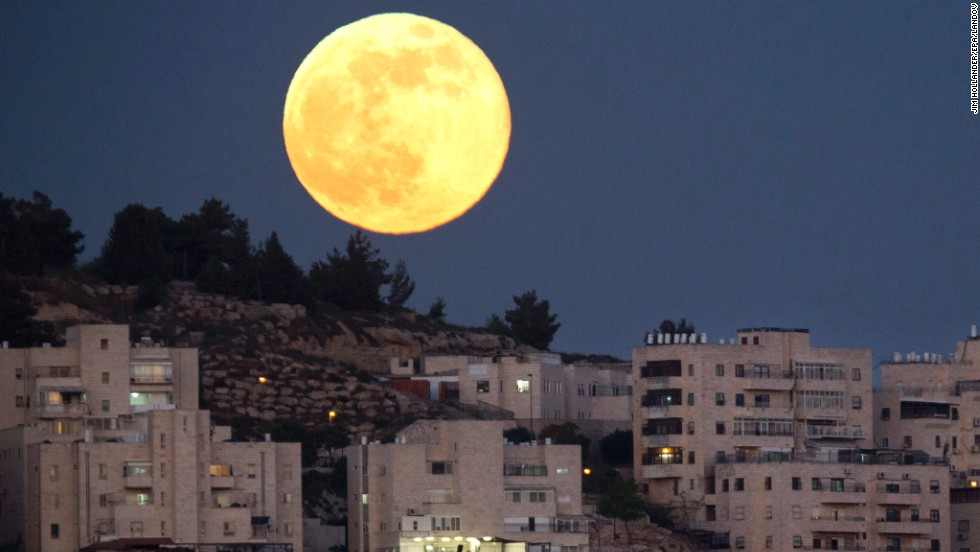 The biggest and brightest moon of the year rises over a Jerusalem neighborhood on Sunday, June 23. The magic moment happened early June 23, 2013, when<a href='http://www.cnn.com/2013/06/22/us/supermoon-sunday/index.html'> the moon was at the closest point to Earth in its orbit</a>. A supermoon, which occurs once a year, is 14% larger and 30% brighter than most full moons, <a href='http://moon.nasa.gov/newsdisplay.cfm?Subsite_News_ID=44049&SiteID=6&iSiteID=1' target='_blank'>according to NASA</a>.