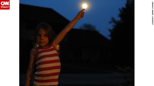 <a href='http://ireport.cnn.com/docs/DOC-994716'>Sarah Schmidt</a> captured her daughter Katelyn in an E.T.-inspired pose in Neenah, Wisconsin.