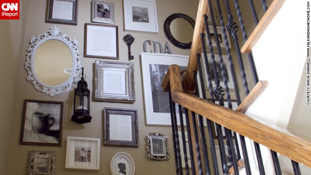 <a href='http://ireport.cnn.com/docs/DOC-991000'>Anisa Darnell's</a> Roswell, Georgia, home came with a huge blank wall along the staircase. She filled it with a collage that is a tribute to her family.