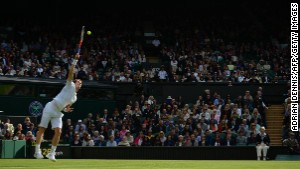 Britain's Andy Murray serves against Germany's Benjamin Becker during their first-round match on the first day of the 2013 Wimbledon Championships in London on Monday, June 24.