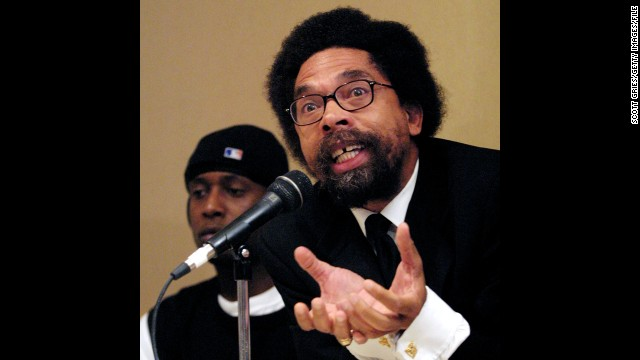 """Pictured behind author Cornel West at the 2001 Taking Back Responsibility hip-hop summit, Kweli has always been known for the intelligence and thoughtfulness of his lyrics. With """"Prisoner of Conscious,"""" he'd like to be known for his music, too, he says."""