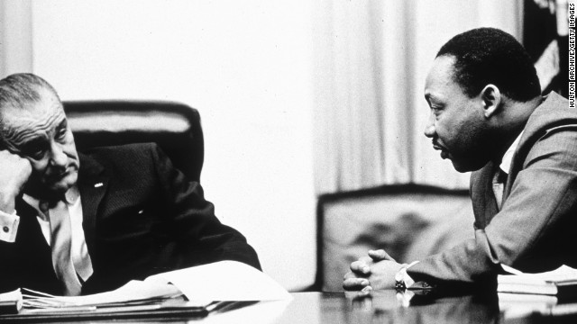 "President Lyndon Johnson, pictured here discussing the act with the Rev. Martin Luther King Jr. in 1965, went on national television to call for passage of the Voting Rights Act. He ended his speech by saying, ""And we shall overcome."""