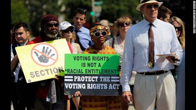 Supporters of the Voting Rights Act listen to speakers discussing the rulings outside the U.S. Supreme Court building on Tuesday, June 25.