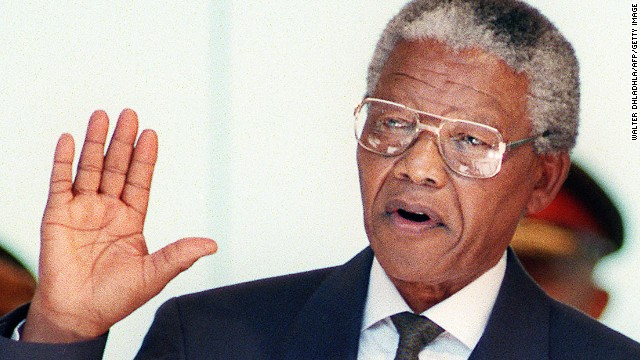 Mandela was elected president in the first open election in South African history on April 29, 1994. He's pictured here taking the oath at his inauguration in May, becoming the nation's first black president.
