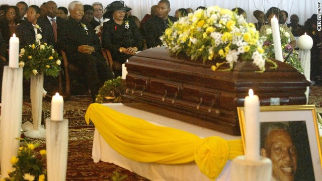 Mandela sits with his wife, Graca Machel, and his grandchildren at his son's funeral on January 15, 2005. He disclosed that his son, Makgatho Lewanika Mandela, had died of AIDS and said the disease should be given publicity so people would stop viewing it as extraordinary.