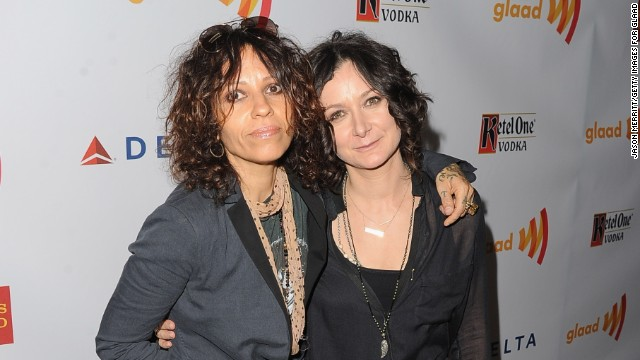 Linda Perry, left, and Sara Gilbert are adding an addition to their family. The couple, who wed in March, are now expecting their first child together. Gilbert has two kids from a prior relationship with TV producer Allison Adler.