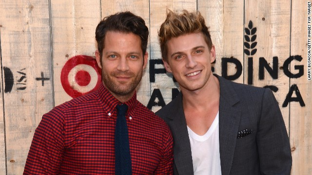 Interior design guru Nate Berkus, left, and Jeremiah Brent were photographed engaging in some PDA after their engagement in April.