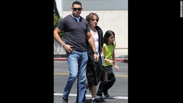 Prince and Blanket are photographed for the first time since Paris was hospitalized, <a href='http://www.cnn.com/2013/06/07/showbiz/paris-jackson-probe'>where she remains today</a>.