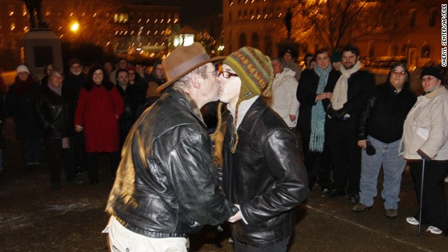 Olin Burkhart, left, and Carl Burkhart kiss on the steps of the New Hampshire Capitol in Concord in January 2010 as the state's law allowing same-sex marriage goes into effect.