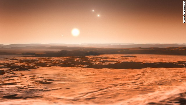 Scientists announced in June 2013 that three planets orbiting star Gliese 667C could be habitable. This is an artist's impression of the view from one of those planets, looking toward the parent star in the center. The other two stars in the system are visible to the right.