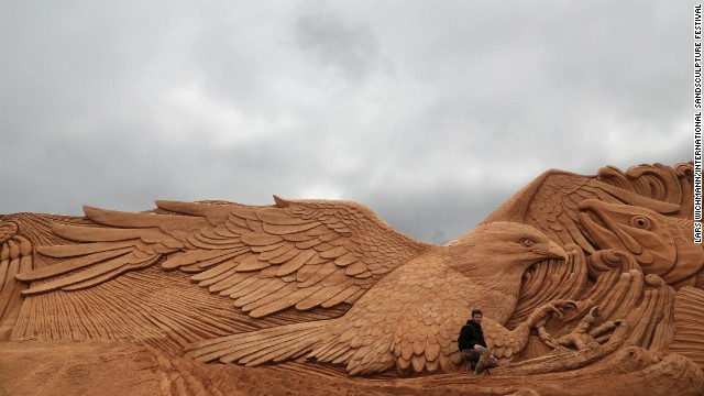 "Marjon Katerberg poses with ""Eagle Dance,"" at the<a href='http://www.sandskulptur.dk' target='_blank'> International Sand Sculpture Festival.</a>"