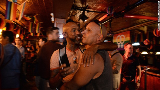Patrons of the Stonewall Inn in New York gather to hear the Supreme Court rulings.