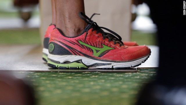 Davis wore a pair of pink tennis shoes in place of her dress shoes in preparation for hours of speaking.