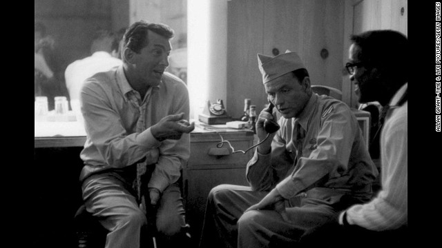 "Davis Jr. visits Frank Sinatra and Dean Martin at MGM Studios, where the duo were making Some Came Running in 1958. The movie co-starred Rat Pack ""mascot"" Shirley MacLaine, who years later would affectionately describe her old friends as ""primitive children who would put crackers in each other's beds and dump spaghetti on new tuxedos."""