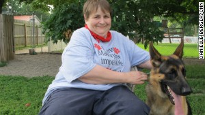 Karen Shirk, pictured here with Gabriel, matches service dogs and people through her nonprofit, 4 Paws for Ability.