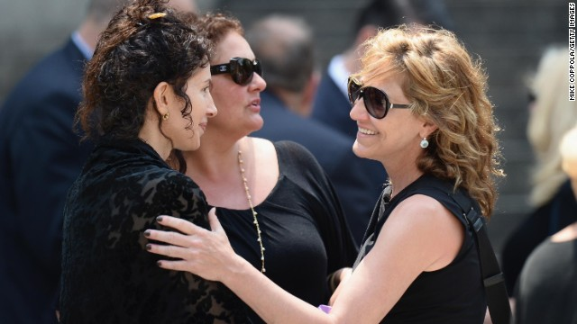 Aida Turturro, center, and Edie Falco, right, attend the funeral.