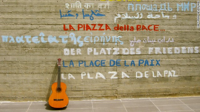 "In one photography exercise, Sara asks the youths to take 100 digital photos of one object. 16-year-old Youssef's photo, titled ""Notes Bring Peace,"" shows a guitar propped against a wall emblazoned with the words ""Peace Square"" in several different languages."