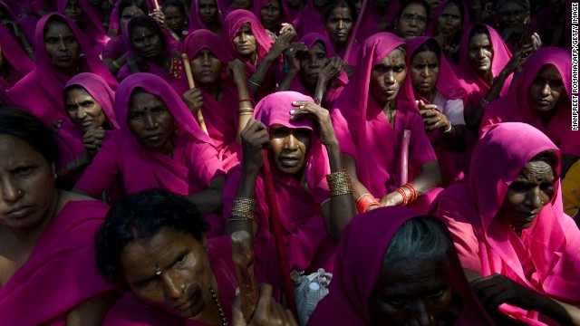 Members of the Gulabi Gang participate in a protest in New Delhi on September 17, 2009. The social justice and women's rights group is known for donning pink saris.