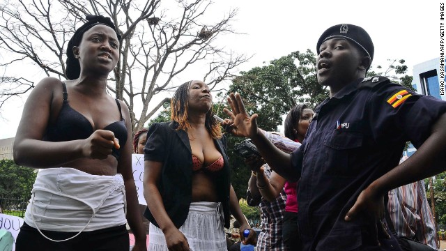 Bra-clad women confront a police officer in Kampala, Uganda, on April 23, 2012. The demonstration was held to protest the alleged sexual assault of a high-profile female opposition politician by a police officer during her arrest. Six women were arrested after they refused to put their shirts on.