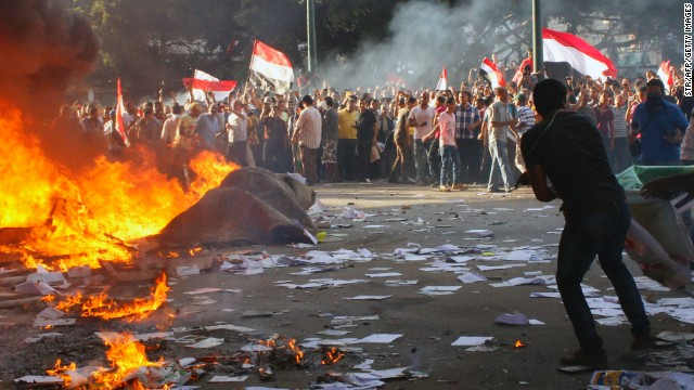 Opponents of President Mohamed Morsi burn the contents of a Freedom and Justice Party office in Alexandria on Friday.