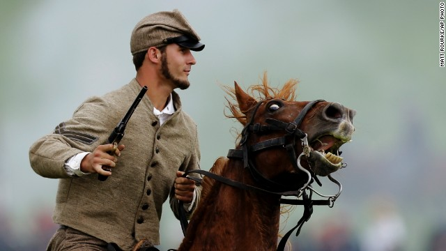 A mounted Confederate reenactor takes part in a demonstration. Besides portrayals of the fighting, the reenactment includes about 200 individuals representing the townspeople of Gettysburg in 1863.