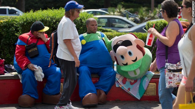 David Reyes, left, and Shavaar Hanes take a break from posing for photos with tourists as the Mario Brothers along the Las Vegas Strip on June 28.