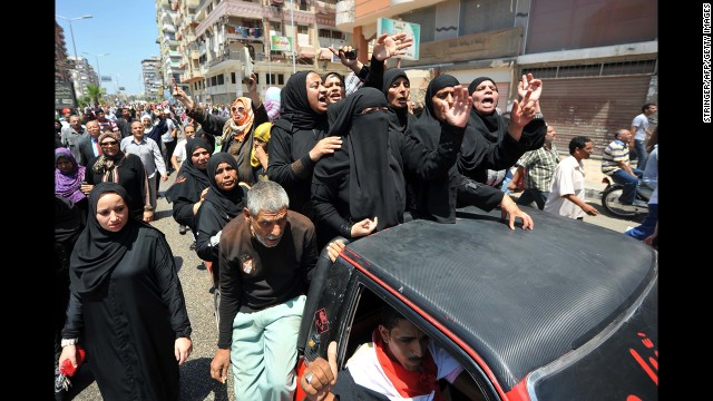Mourners shout slogans during journalist Salah Hassan's funeral on June 29 in Port Said.