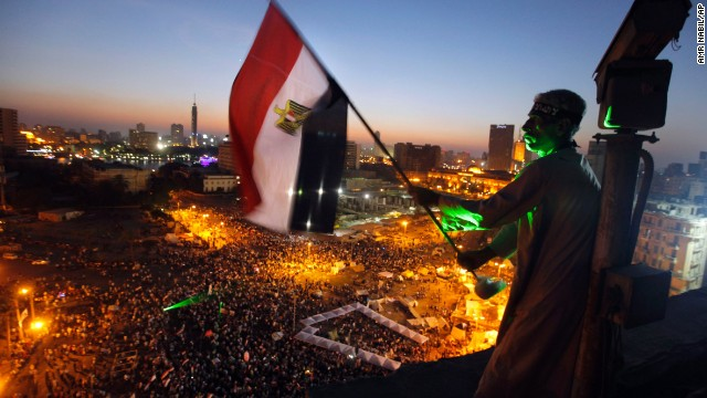 A protester waves a national flag over Cairo's Tahrir Square, where Morsy opponents gathered on June 28.