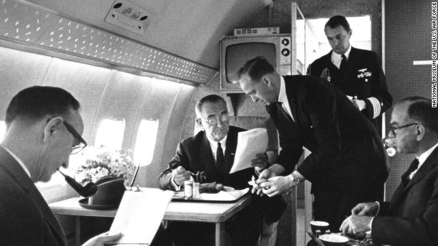 President Johnson is seen here meeting with Sens. Mike Mansfield, left, and J. William Fulbright, far right. All presidents aboard Air Force One used it to multitask. For example, at a 1964 campaign stop, LBJ gave an impromptu press conference on the plane while he changed clothes.