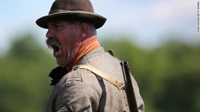 A Confederate soldier yells orders during a reenactment in Gettysburg on June 29.