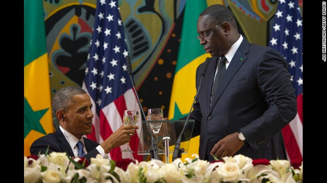 Obama toasts with Senegalese President Macky Sall during an official dinner at the Presidential Palace in Dakar on Thursday, June 27.