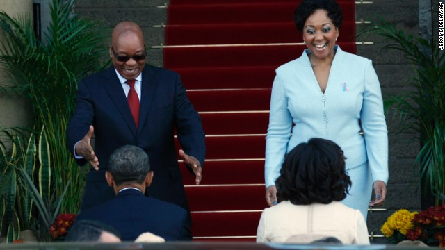 Obama, foreground left, and first lady Michelle Obama, beside him, are greeted by South African President Jacob Zuma and his wife, Tobeka Madiba Zuma, on the steps of the Union Buildings upon their arrival in Pretoria, South Africa, on Saturday June 29.