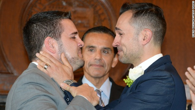Jeff Zarillo, left, and Paul Katami, plaintiffs in the California case against Proposition 8, react after they are married by Los Angeles Mayor Antonio Villaraigosa at Los Angeles City Hall on June 28.