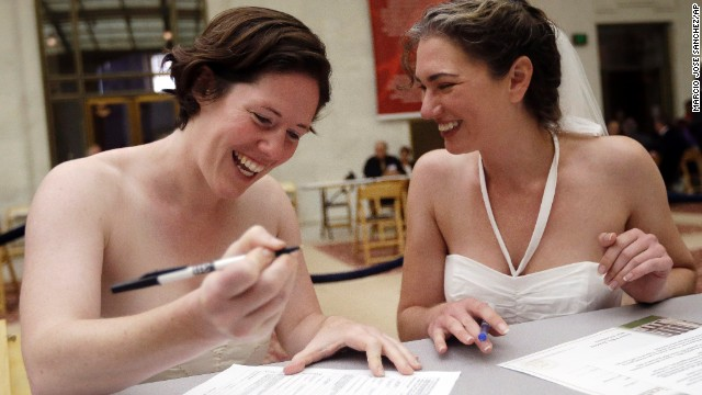 Cynthia Wides, right, and Elizabeth Carey file for a marriage certificate at City Hall in San Francisco on Saturday, June 29.