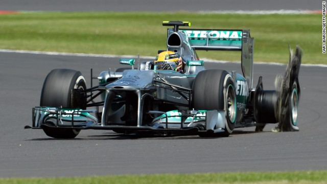 Hamilton's hopes of a home win at Silverstone ended after just eight laps when his Mercedes suffered a puncture.