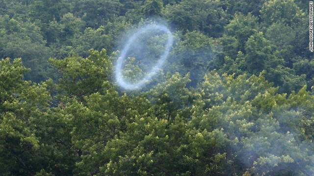 A smoke ring from a cannon fired by Confederate Civil War reenactors wafts skyward on June 30.