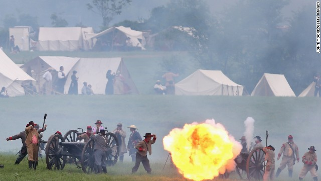 A ball of flame erupts from a Confederate canon during the reenactment on June 30.