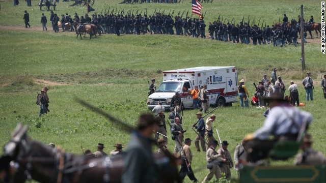 An ambulance, taking several people away due to heat exhaustion, departs the area on June 30.