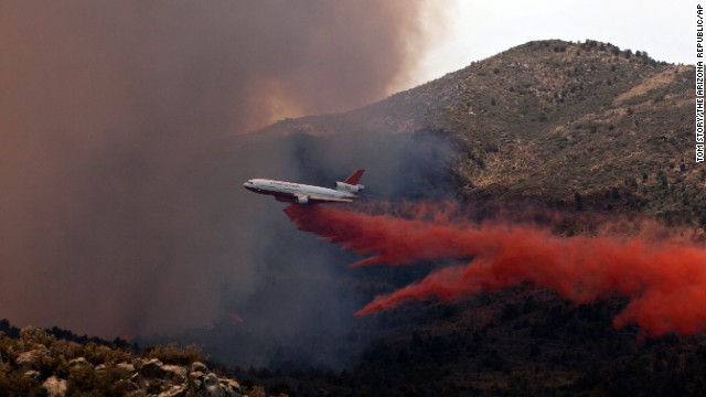 Tanker 910 makes a retardant drop on the Yarnell Hill Fire to help protect the Double Bar A Ranch near Peeples Valley on June 30.