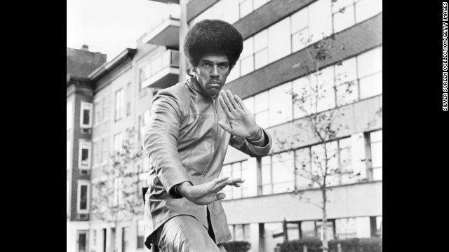 "Jim Kelly, a martial artist best known for his appearance in the 1973 Bruce Lee movie ""Enter the Dragon,"" died on June 29 of cancer. He was 67. After a brief acting career, he became a ranked professional tennis player on the USTA senior men's circuit. Here he appears in the 1974 film ""Three the Hard Way."""